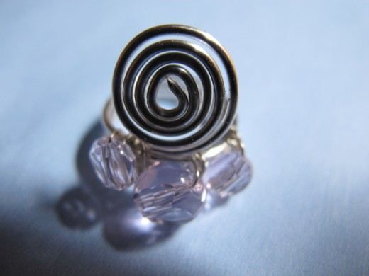 Spiral ring with pink crystals