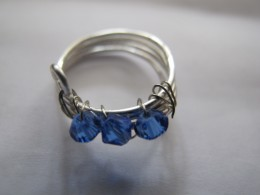 Coil ring with blue Swarovski crystals