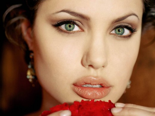 """Angelina Jolie's trademark look of """"intrigue""""-- worth making men leave their loving wife to give her a chance."""
