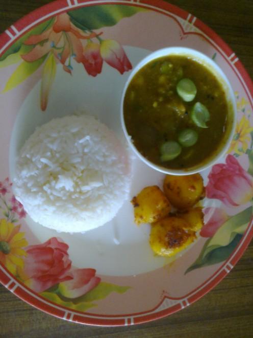 Rice, Sambhar(lentils broth) and Roast Potato