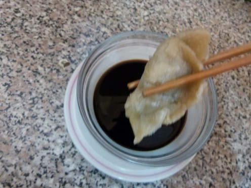 Steamed dumplings and dipping sauce