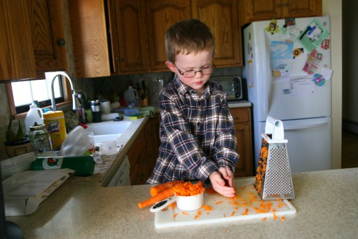 My four year old son measures 2/3 cup shredded carrots.