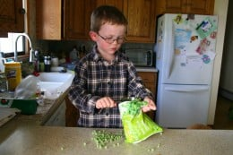 My four year old discovers various methods of measuring 1 cup frozen peas.