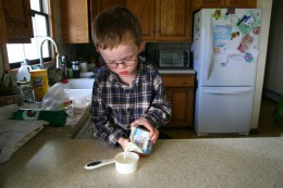 Measuring 1/2 cup cream. We often use light cream in this recipe.