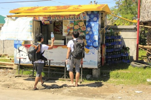 Grabbing a bite of buy one take one burgers right outside the Kalibo airport