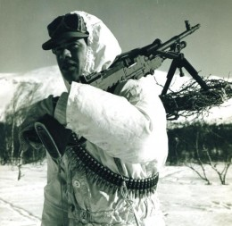 A british solider geared for fighting in the snow.