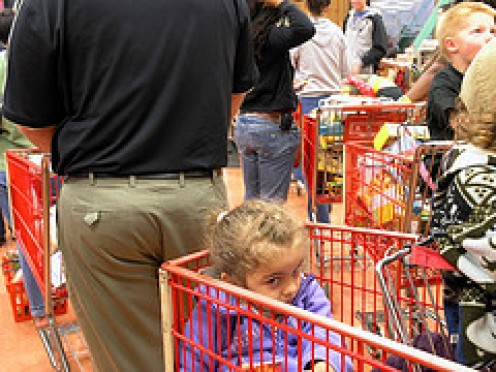 This child is doing the right thing in being quiet while the long line at the grocery store is slowly moving forward. Parents, teach your children to stay as quiet as possible when in a long line. The child crying for no reason can upset the cashier.