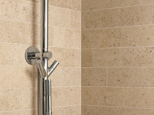 Moleanos beige limestone looks wonderful in both bathrooms and kitchens, and shows an interesting range of natural fossils.