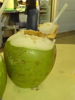 coconut water being drunk from the fruit