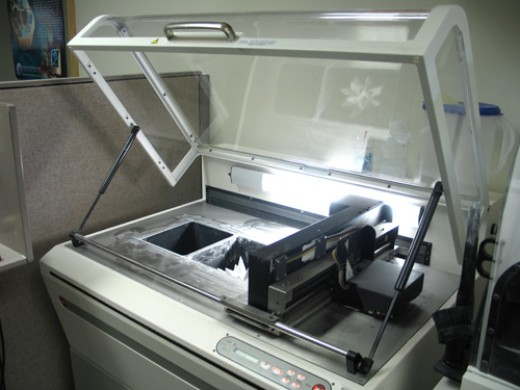 An example of a old style 3D printer. This is a much larger one although there are 3D printers available the size of a normal printer (look below at other pictures).
