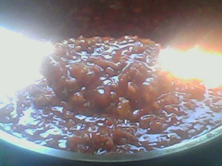 The pasta sauce mixture being simmered