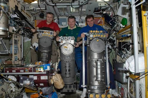 Russian cosmonauts in the Zvezda Service Module of the International Space Station. See any places microbes might hide?