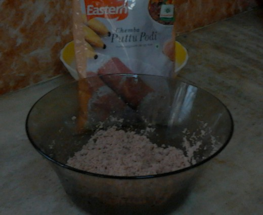 Wet puttu powder using warm water mixed with needed salt to taste