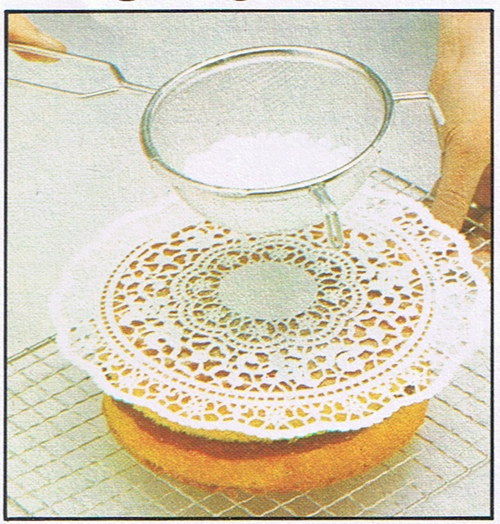 Place a doily on top of the cake and sift on icing sugar