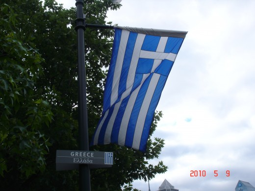 a cross in the top left corner, 5 blue stripes, 4 white stripes