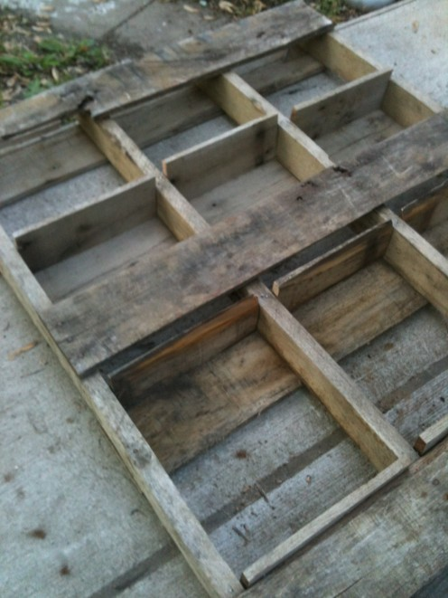 Step 5:Once they are nailed in, lay the pallet facedown. Notice how the bases were nailed on. Grab your landscape fabric and staple gun.