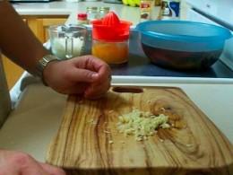 Mince three cloves of garlic.