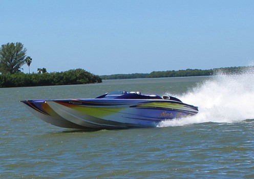 A super boat practices on the Intracoastal Waterway the weekend of the Super Boat Championships. In the background you can see two spoil islands and beyond them Caladesi Island.