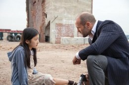 """Catherine Chan stars as Mei, a young girl with a gift for memorization and Jason Statham is an ex-cop who takes it upon himself to protect her from rival gangs in """"Safe""""."""