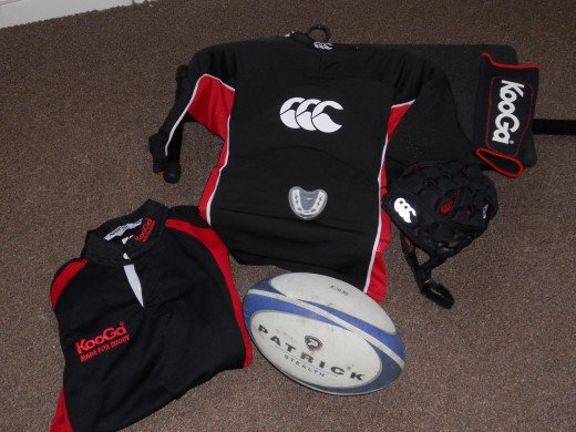 From left to right: Technical shirt, Rugby Ball, Tackle Pads, gum shield (on pads), scrum cap, arm guard.