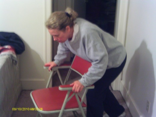 If alone press the abdomen against a chair, table edge or railing.