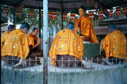 These statues in Deer Park, India, are a Sri Lankan representation of the Buddha offering his first sermon on the nature of suffering and how to live free of suffering. I took the photo on my pilgrimage to India in 2002