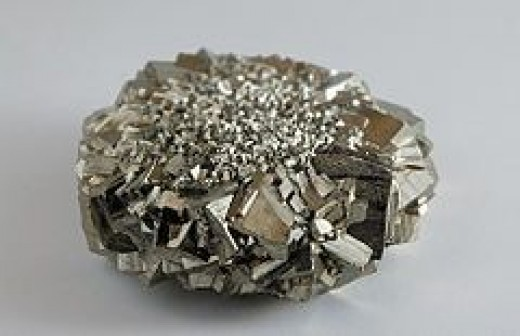An egg-size cluster of Iron Pyrite crystals.  Magnified to show the astounding facets