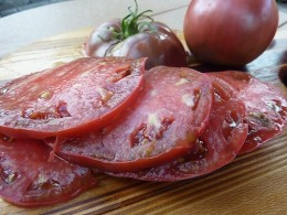 This is a carbon tomato, about half a pound with rich earthy tomao flavor.