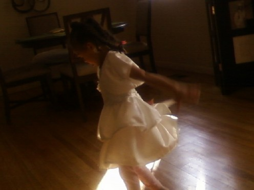 Picture of my daughter dancing and swinging her arms.