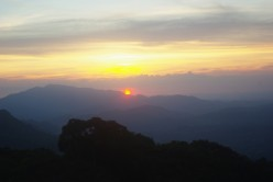 Watching the splendid sunset on the summit of the Mt. Daguldol