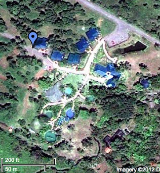 A satellite-eye's view of Blue River Resort, showing the 5 pools, cabins and the spa building.