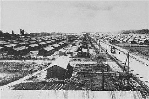 Row upon row of barracks disappearing into the horizon where camp inmates were housed at night after days spent in forced labor.