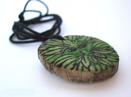 This pendant was made by cutting a slice off a fallen branch