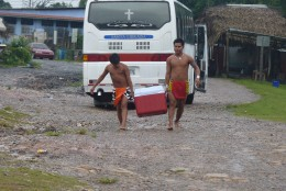Embera Indians bringing in water bottles for our lunch.
