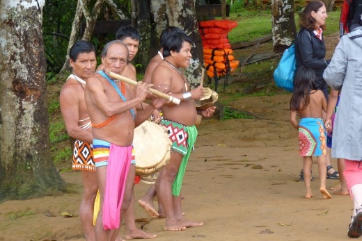 Embera Indian band welcoming us to their village.
