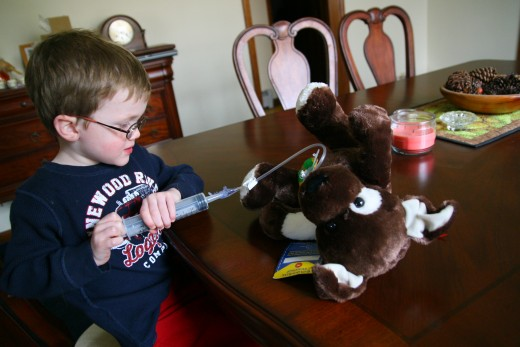 Our son plays with his Tubie Friend. This stuffed animal has been outfitted with a Mic-Key g-tube, and made the preparation for surgery easier.