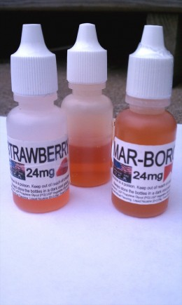 "E-liquid is heated to produce the e-cigs vapor.  E-liquid can come with or without nicotine, and is available in pre-filled cartridges called ""cartomizers"", or separately for use on an atomizer like these bottles shown here."