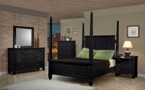 A queen size four poster bed in a rich black finish.
