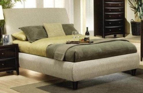 A queen size upholstered platform bed in a beige fabric.