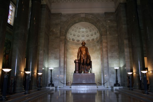 The 17-foot bronze statue of George Washington is a dramatic visual focus.