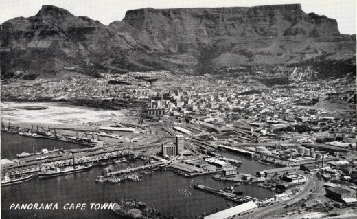 Old postcard with the city and the mountain
