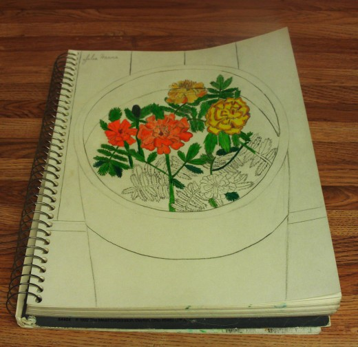 The half-way point is reached now that I have finished coloring in most of the marigolds.