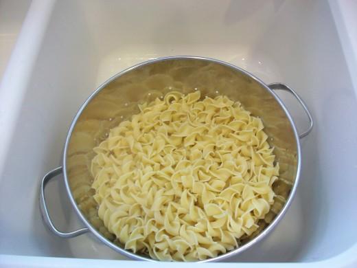 Wide egg noodles give a good foundation to this ooey-gooey dish.