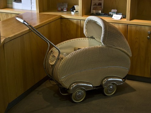 Beautifully crafted wicker pram with chrome 'hubcap' accents. probably 1950s .