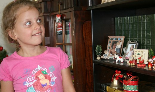 My daughter Caitlin looks at some of her grandmmother's home-made Christmas decorations