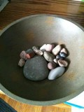 A hand-painted bowl with some colorful lake stones can make a simple table piece.