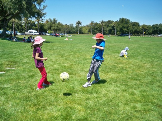 Children Playing Soccer in a Park