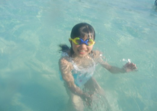 A Kid Playing in Water