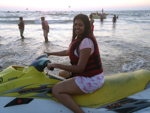 A girl going on a jet ski ride at Calangute Beach Goa