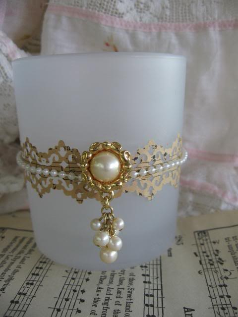 Earring, string of pearls and paper lace